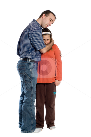 Father Daughter Isolated On White stock photo, A father comforting his preteen daughter isolated against a white background by Richard Nelson