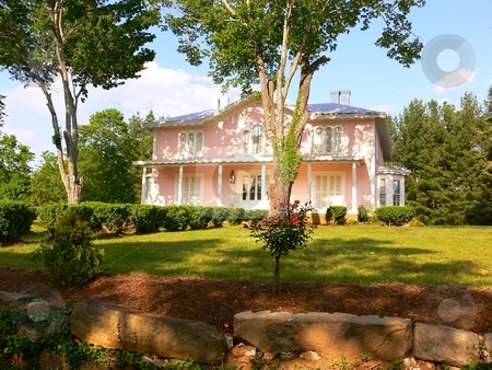 Pink mansion    stock photo, An big pink mansion in an park in the green hills of Virginia. by Horst Petzold