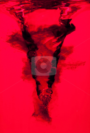 Red water swirl vortex stock photo, Side view of an underwater red vortex swirl with dark ink clouds, isolated by Paul Hakimata