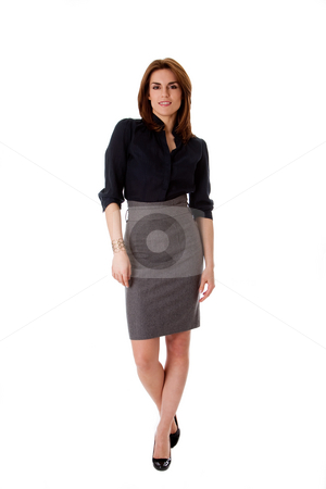 Beautiful business woman stock photo, Beautiful brunette business woman in walking pose wearing gray skirt and blue blouse, isolated by Paul Hakimata