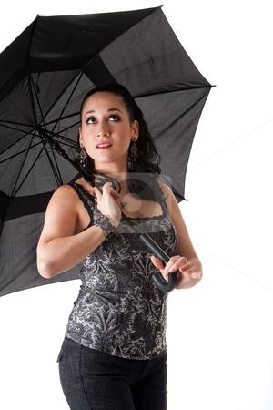 Beautiful woman with umbrella stock photo, Beautiful caucasian woman with umbrella looking up, isolated by Paul Hakimata