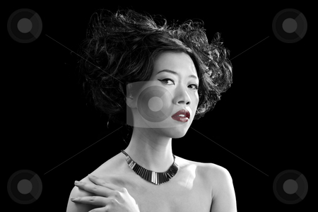 Asian woman with red lips stock photo, Beautiful Asian woman with red lips and bare shoulders in black and white, isolated by Paul Hakimata
