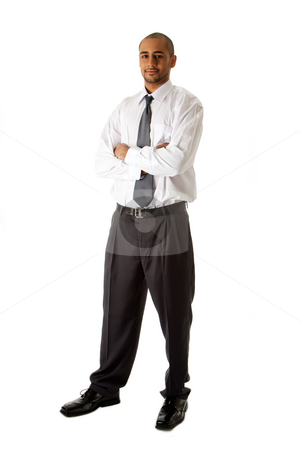 Handsome business man standing stock photo, Handsome African Hispanic business man in white shirt, gray pants and tie, standing with arms crossed, isolated by Paul Hakimata