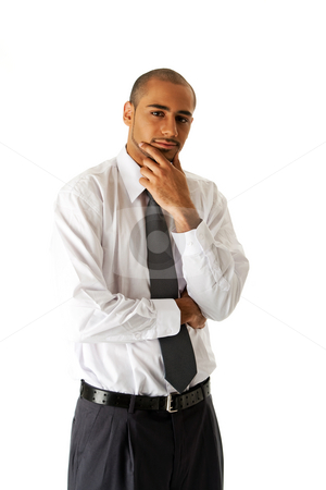 Handsome business man standing stock photo, Handsome African Hispanic business man in white shirt, gray pants and tie, standing with hands on chin thinking, isolated by Paul Hakimata