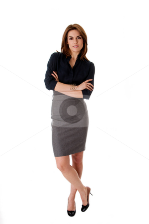 Beautiful business woman stock photo, Beautiful brunette business woman standing wearing gray skirt and blue blouse with arms crossed, isolated by Paul Hakimata