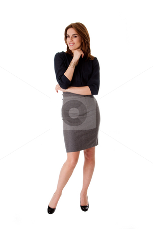 Beautiful business woman stock photo, Beautiful brunette business woman standing wearing gray skirt and blue blouse with hand on chin, isolated by Paul Hakimata