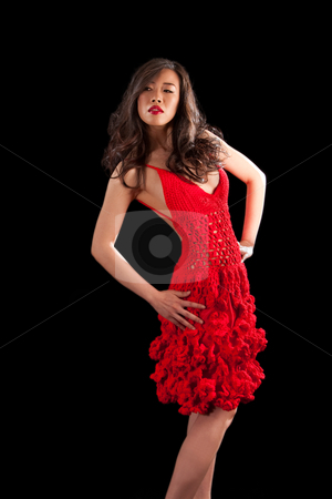 Asian woman in red crochet dress stock photo, Beautiful sexy Asian woman in a crochet red dress, isolated by Paul Hakimata