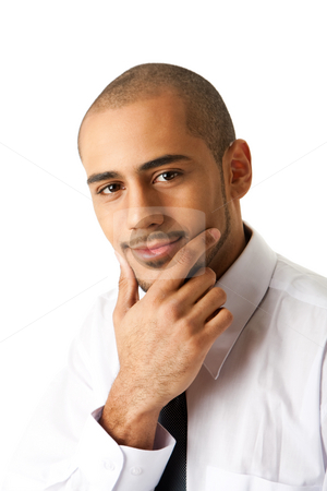 Handsome business man stock photo, Torso of a handsome African Hispanic business man in white shirt and gray tie with hand on chin and thinking, isolated by Paul Hakimata