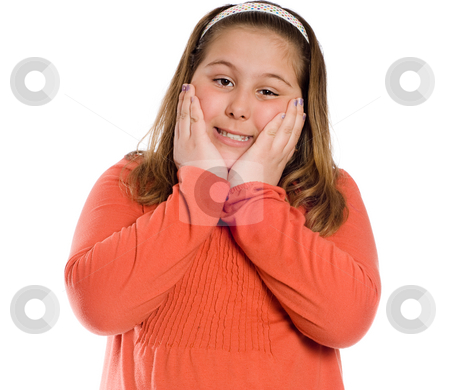 Hands On Cheeks stock photo, A smiling girl posing with her hands on her cheeks, isolated against a white background by Richard Nelson