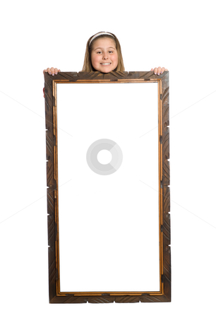 Child Holding Display stock photo, Full body view of a young girl standing behind a large display, isolated against a white background by Richard Nelson