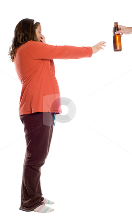 No Beer For Me stock photo, A young girl holding her nose and waving away an offering of a bottle of beer, isolated against a white background by Richard Nelson