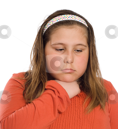 Child With Sore Throat stock photo, Closeup view of a young girl with a sore throat isolated against a white background by Richard Nelson