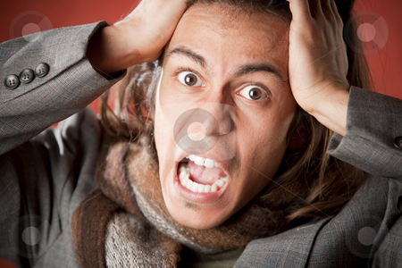 Handsome Young Man Screaming stock photo, Closeup Portrait of a Handsome Young Man with Long Hair Screaming by Scott Griessel