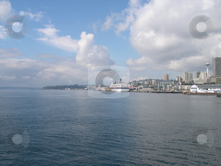 Seattle waterfront  stock photo, View of Seattle as seen from a ferry by Jaime Pharr