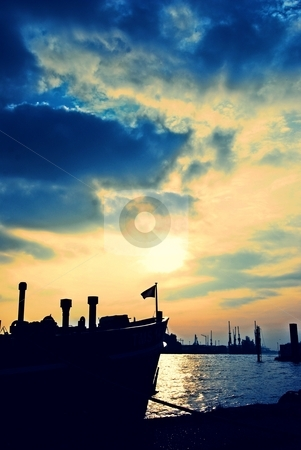 Sunset at the docks stock photo, View at the harbor Hamburg, Germany by Diana Hartmann
