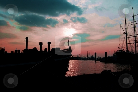 Sunset at the docks stock photo, View at the harbor Hamburg, Germany by Diana Hartmann