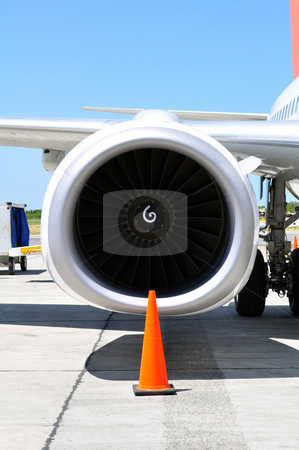 Air transportation: Jet engine detail stock photo, Commercial airliner: wing and engine detail. by Fernando Barozza