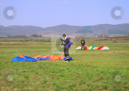 Parachutes landed stock photo, Two parachutes landed on the grass field. by Ivan Paunovic