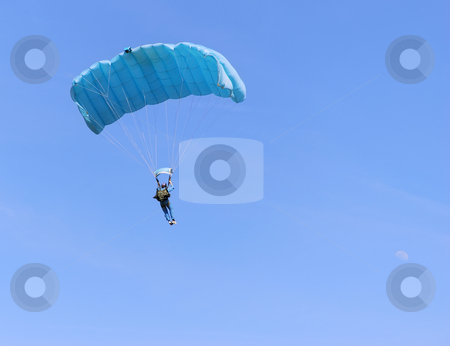 Blue parachute stock photo, A blue parachute on a bright sunny day. by Ivan Paunovic