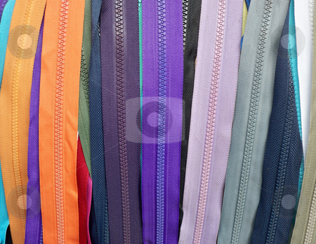 Colourful Zippers stock photo, Colourful zippers hanging on a rack by Serda Yilmaz
