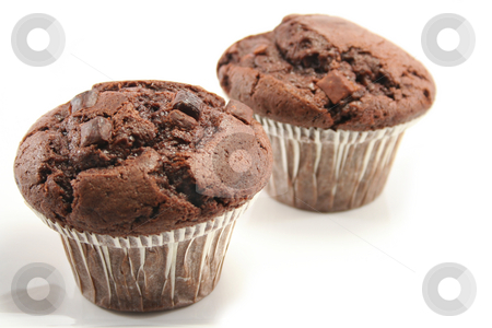 Chocolate Muffins stock photo, Two tasty chocolate muffins, focus on front one by Helen Shorey