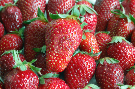 Strawberries stock photo, Close up of fresh spring strawberries texture. by ALESSANDRO TERMIGNONE