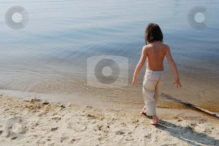 Girl stepping into water stock photo, 7-year girl comes close to water by Leyla Akhundova