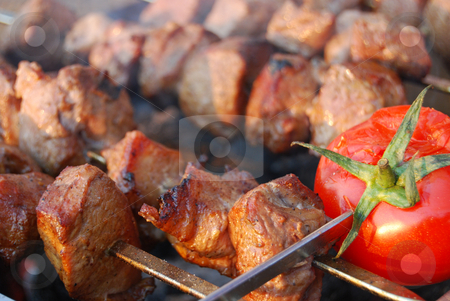 Shashlik stock photo, Tasty fried pork with tomato by Leyla Akhundova