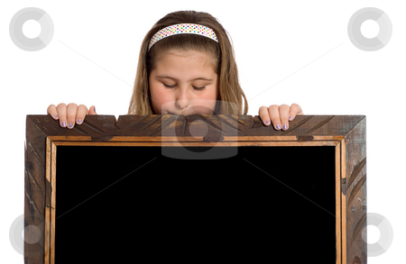 Child Reading Your Text On Black stock photo, A young girl looking over a wooden frame to look at your text or picture by Richard Nelson