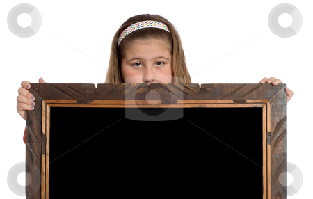 Child Holding Frame stock photo, A preteen girl holding a wooden frame with a black interior isolated against a white background by Richard Nelson