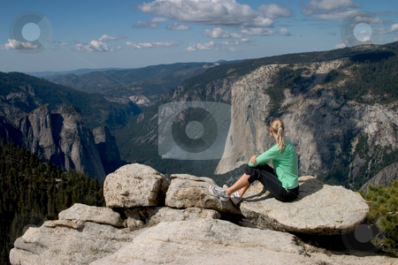 Hiker Overlooking Yosemite Valley I stock photo, Posed composition from the top of Sentinel Dome, Yosemite NP. by Rick Parsons