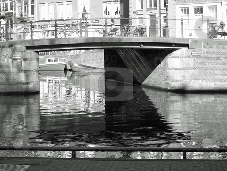 Amsterdam canal stock photo, Black and white image of canal bridge in Amsterdam by Jaime Pharr
