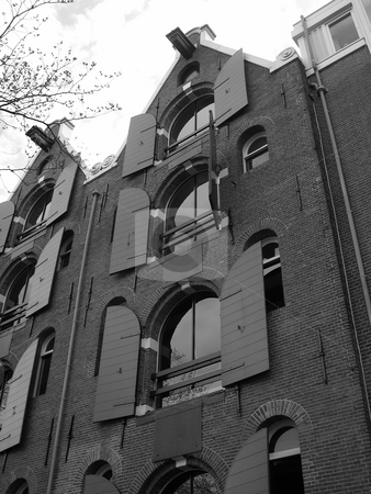 Open shutters in Amsterdam stock photo, Black and white image of building with open shutters in Amsterdam by Jaime Pharr