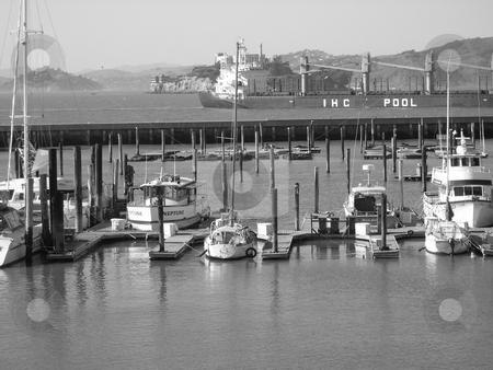 Alcatraz prison and boats stock photo, Black and white image of Alcatraz prison with boats in the foreground, San Francisco by Jaime Pharr