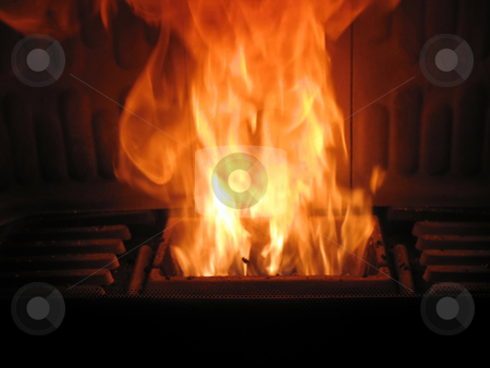 Fireplace pellets stock photo, Fireplace is burning wood pellets by Roberto Marinello