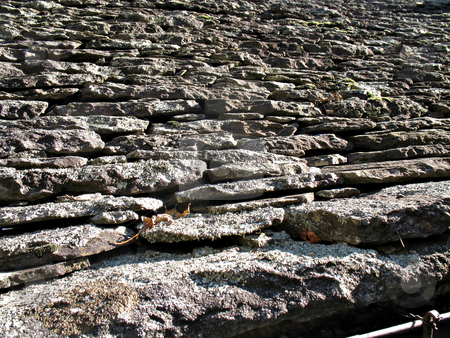 Old roof stock photo, An old roof with tiles made of stones by Roberto Marinello