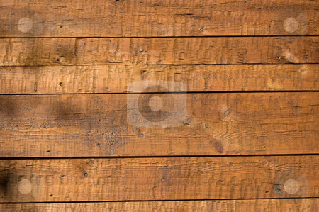 Wooden boards wall  stock photo, Facing of wooden boards of a wall. Side of an old alpine refuge by Roberto Marinello