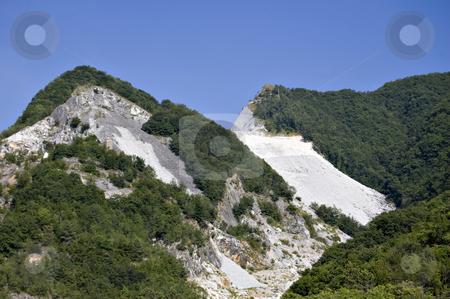 Quarry of white marble stock photo, An open quarry of white marble in Carrara, Tuscany, Italy by Roberto Marinello