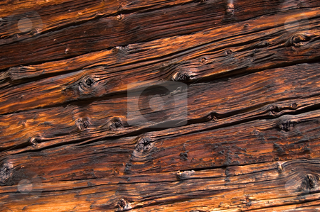 Aged wooden boards stock photo, Facing of wooden boards of a wall. Side of an old alpine refuge by Roberto Marinello