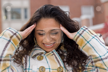 Overloaded and Fed Up stock photo, This woman is experiencing an intense amount of stress or possibly a headache. by Todd Arena