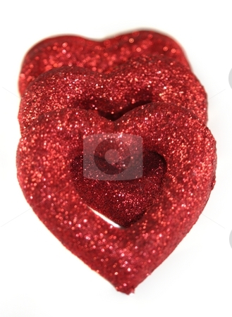 Hearts stock photo, Pieces of a red broken hard on white background by Henrik Lehnerer