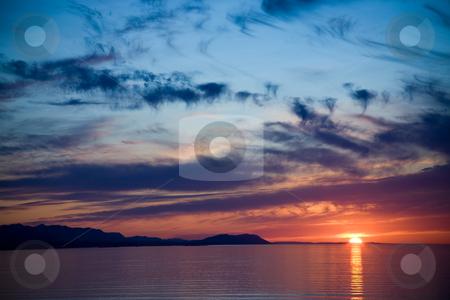 Strait of Juan de Fuca Sunset stock photo, A beautiful sunset over the Strait of Juan de Fuca in Sequim, Washington. by Travis Manley
