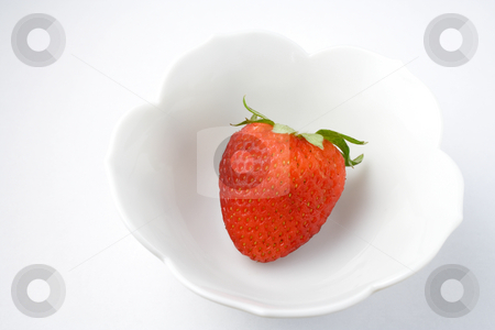 Strawberry stock photo, Single strawberry in dish for healthy eating by Ira J Lyles Jr