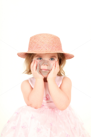 Portrait of young girl  stock photo, Portrait of young girl in pink princess dress and hat with hands on face, studio shot by Tom P.