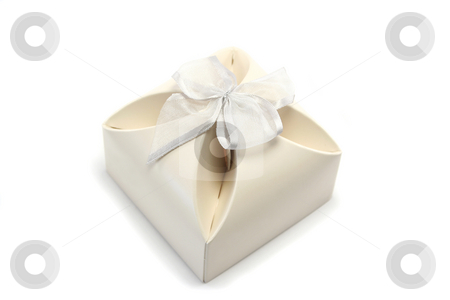 Gift Box 2 stock photo, Small gift box in cream cardboard with a slivery bow - often used for wedding favours by Helen Shorey