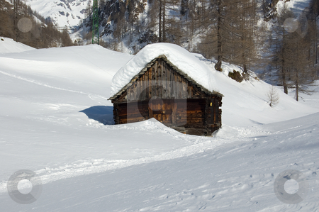Alpine wooden house in the snow stock photo, Alpine house in a snowy winter landscape; Alpe Devero, Alps, Italy by Roberto Marinello