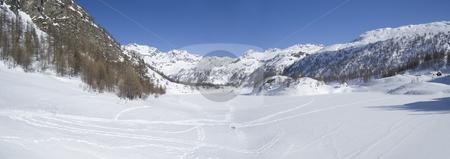 Icy winter alpine lake stock photo, Icy alpine lake landscape full of snow; Alps, Italy by Roberto Marinello