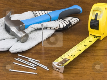 Many tools stock photo, Many tools laying on a wooden background by John Teeter