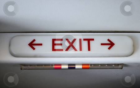 Exit sign stock photo, Exit sign in passengers cabin of commercial airliner by Fernando Barozza