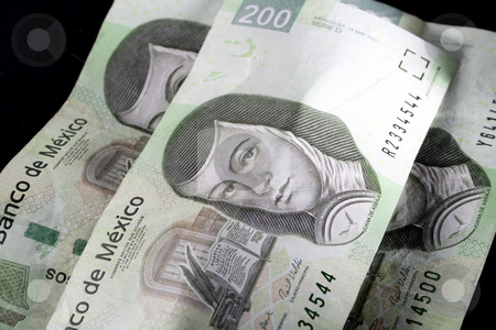 Mexican Money stock photo, Close-up of three of mexico's two hundred peso bill by iodrakon